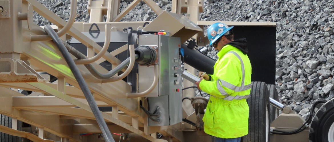 Service Technician starts up Radial Stacking Conveyor.